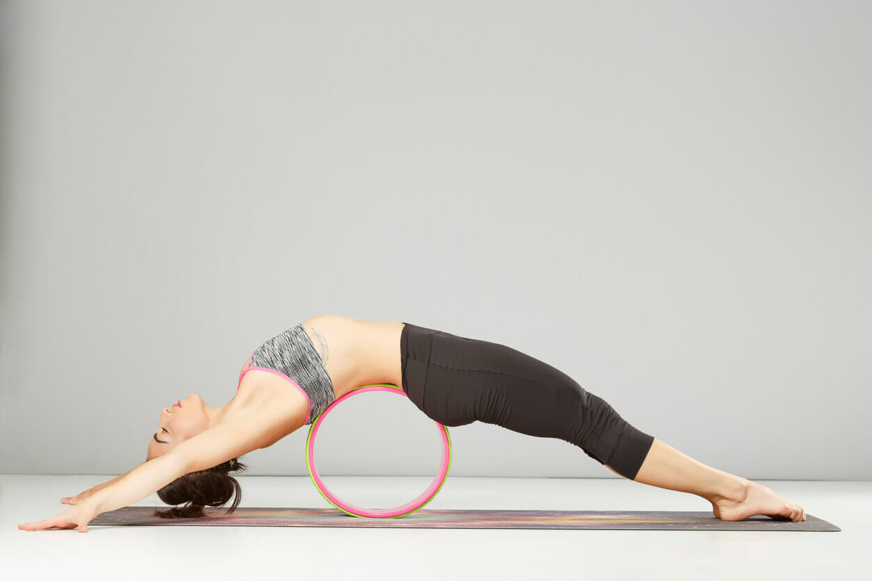 7 Benefits Of Using A Yoga Wheel Pilgrimage Yoga Online